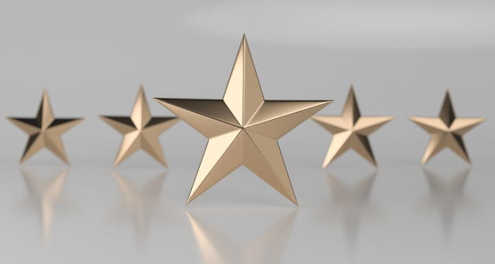 Five gold stars on a gray background