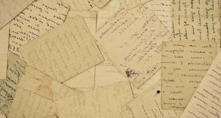 a collection of old letters on yellowed paper