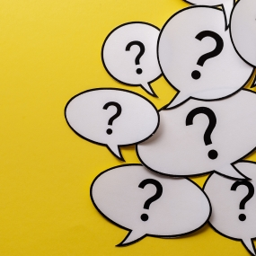 Question marks in with Chat bubbles on yellow background