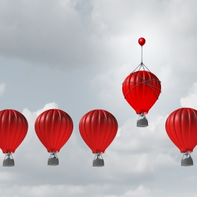 Red hot air balloons in a row