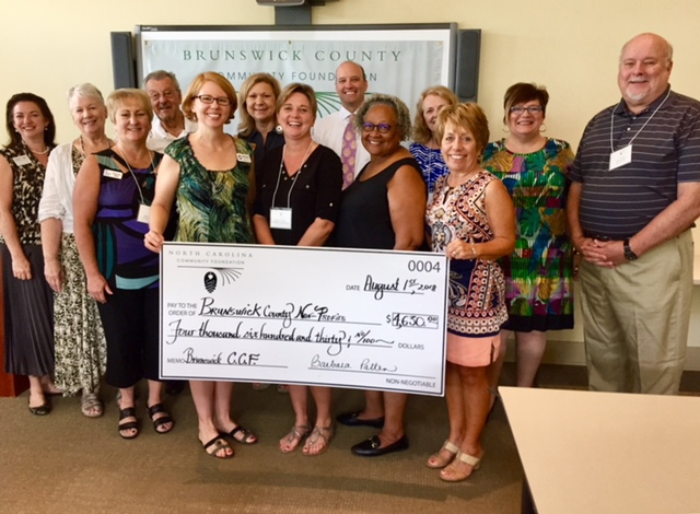(Left to right) Heather Holbrook (Carol Steen Community Counseling Center Board Member), Bonnie Jordan (Communities in Schools), Bill Hogue (Southport-Oak Island Interchurch Fellowship), Julie Bowling (Diaper Bank of NC Lower Cape Fear), Connie Hill (Lump to Laughter), Sonya Leonard (Community Counseling Center), Justin Wolfe, Mary Collins-Walton, Rosemarie Allen, Barb Patten, Cindy Cheatham and Mike Gildea (BCCF board members).