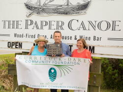 Tommy Karole (middle), owner of Paper Canoe and Best Dish award winner, poses with Janet Colegrove (left), President of the CDCF board, and Loismary Hoehne (right), President of Food for Thought, a nonprofit partner receiving their donation.