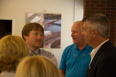 Gathering in historic Hickory for this year's grants reception, NCCF Regional Associate John Francis (left) speaks with Unifour Foundation Board President Chip Huffman (middle) and grantees.