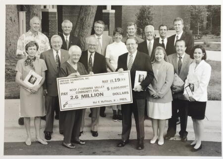 Taken in 1998, this snapshot shows the Unifour Foundation board presenting NCCF with the check. The photo was sent to press in the original release announcing the Unifour Foundation joining NCCF.