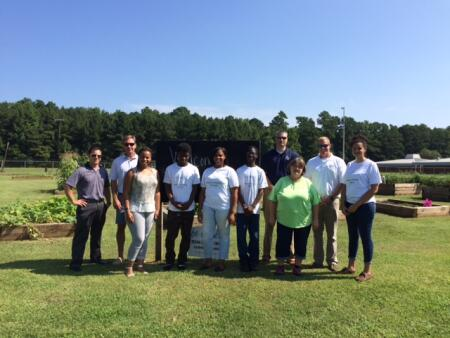 Left to right: Hyde County Representative Will Doerfer, BHCF Board Member Read Allen, Be Global Founder Q-Nisha McNair, Beaufort County teens, BHCF Board Chair Shanon Carter, Be Global Program Director Vickie Jones, BHCF Board Member Stuart O'Neal and Be Global teen.