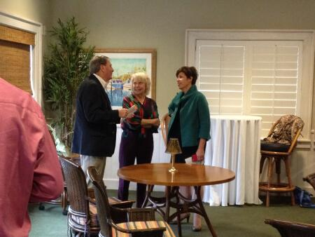 NCCF CEO Jennifer Tolle Whiteside and Statewide Board Chair Linda Staunch talking with CCF Board Member Chuck Jordan.