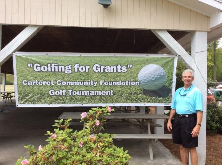 Carteret Community Foundation Board Member Ray Harris welcomes golfers to the tournament.