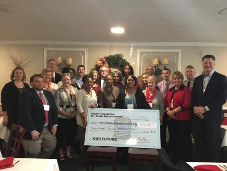 Duplin Foundation for Youth Advancement board members, grantee representatives and community leaders pose for a photo following this year's grants reception with the ceremonial awards check representing local 2016 grants from the Foundation for Youth Advancement.