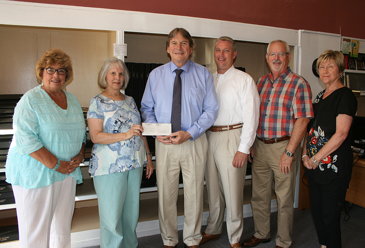 "(From left to right) Judy Davenport (Greene County Community Foundation board member and co-coordinator of the Garden Walk), Rhonda Hughes (""Forever Young Circle"" and Garden Walk co-coordinator) present Michael Rhodes (GCCF president), Jody Tyson, Rick Davis and Randy Davis (GCCF board members) with check."
