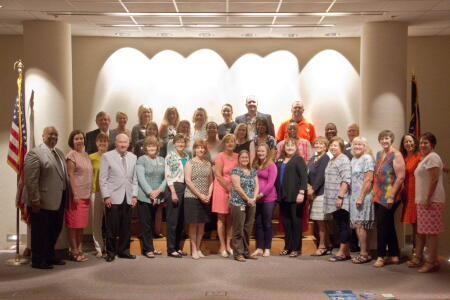 Grant recipients and board members gather for a group photo at the grants ceremony.