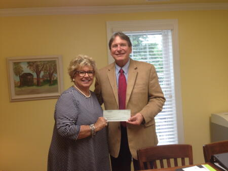 Pictured is Dianne Andrews from Interfaith Volunteers accepting a North Carolina Community Foundation Disaster Relief Fund grant award from Michael Rhodes, Greene County Community Foundation board president.