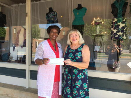 Pictured awarding a grant to Harbor, Inc. Executive Director Katrusia Johnson is Margaret Dinubila, board president.