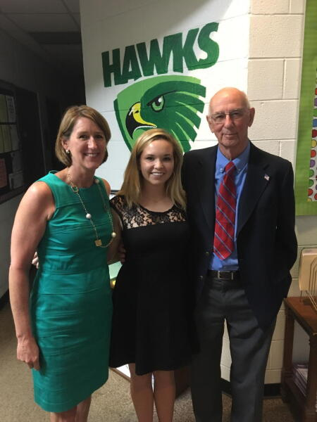Scholarship recipient Caitlin Deans (middle) poses with Anne Klutey Fisher (left) and Fred Klutey.