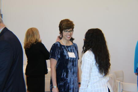 Jennifer Tolle Whiteside, NCCF CEO and president, speaking with a nonprofit leader at Pop-Up Philanthropy.