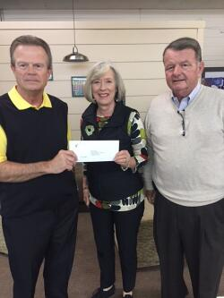 Robeson County Community Foundation Board Vice President Kenny Biggs (left) and Board Member Ken Windley (right) present a disaster relief grant award to Communities in Schools of Robeson County Executive Director Denice Lambdin.