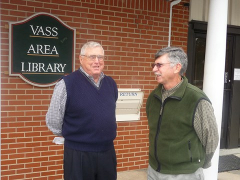 Pete Madsen chats with Phil Keith, whose family donated the building for the library. keith's father orignially built the structure to house the town's movie theatre.