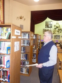The community has really come together to create, build and sustain the Vass Area Library. Pete Madsen admires the shelves built by local resident Lee Maurath.