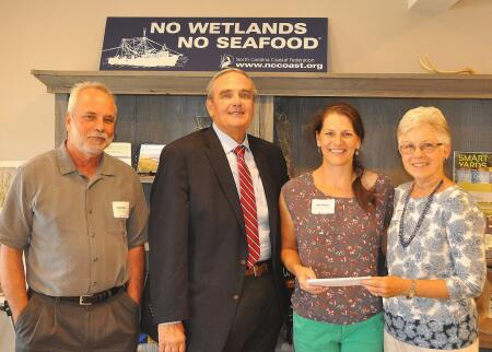 Pictured are (left to right) Todd Miller, executive director of the North Carolina Coastal Federation; Warren Judge, Dare County Commissioner; Peggy Birkemeier, Northeast NC Coastal Research and Environmental Education Fund fundholder; and Ann Daisey, community conservationist for Dare Soil and Water Conservation District and the North Carolina Coastal Federation.