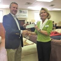 Scott Johnson, executive director of the Pitt County Habitat for Humanity, receives Disaster Relief funds from NCCF Regional  Director Kim Ball.