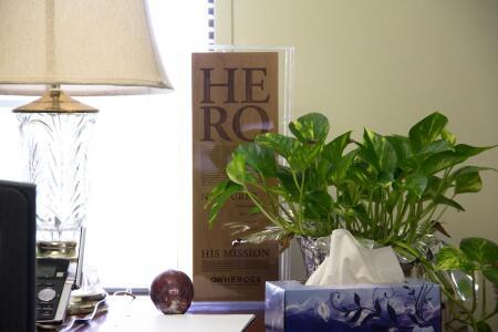 Joyner's CNN Heroes' plaque rests in his modest office.
