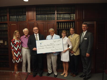 Left to right: Julia Langston, Selection Committee Member Dr. Marion Lark, Floyd Johnson, Selection Committee Chair Preston Powers, Tanya Evans, Selection Committee Member Frank Irvin and Paul Ross proudly pose with a locally awarded grants check.