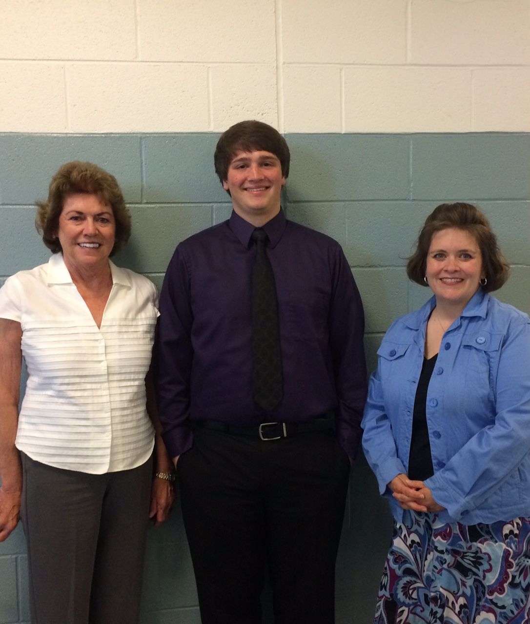 Watauga High School Senior Tyler Price poses for a photo with Billie Howell and Candis Walker.