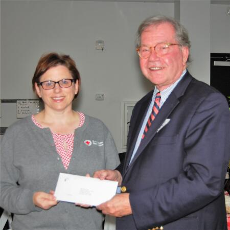 Pictured is Linda Walling, with Hope Station, receiving a grant check to purchase a new computer.