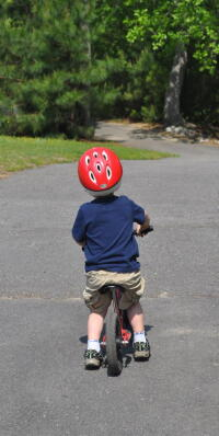Child riding bike in park