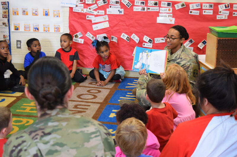 Soldier reads to TISD students on Dr. Seuss Day