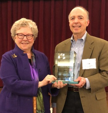 LM Board member Bill Pappas receives award from Catherine Arrowood.