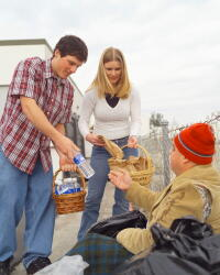 Giving water to homeless