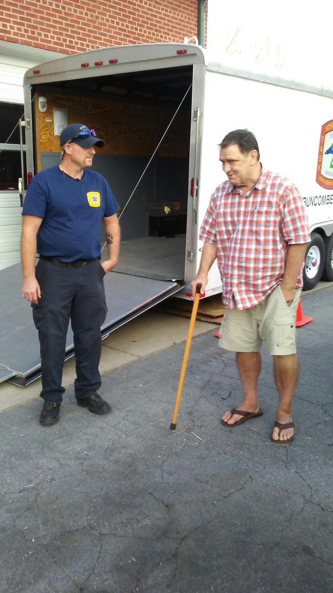 Barry Doyle (right) delivers provisions in western North Carolina.