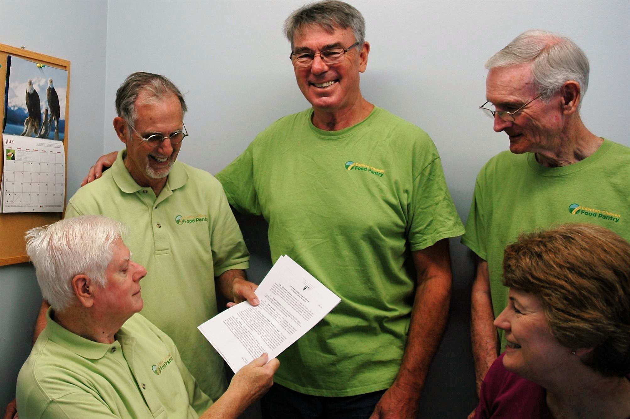 Food Pantry leaders (left to right) Bob Bastek, Roger Coleman, Gerard Cooney, Shaf Shaffer and Lisa Hoggard signing the paperwork to found the Pantry's endowment fund.