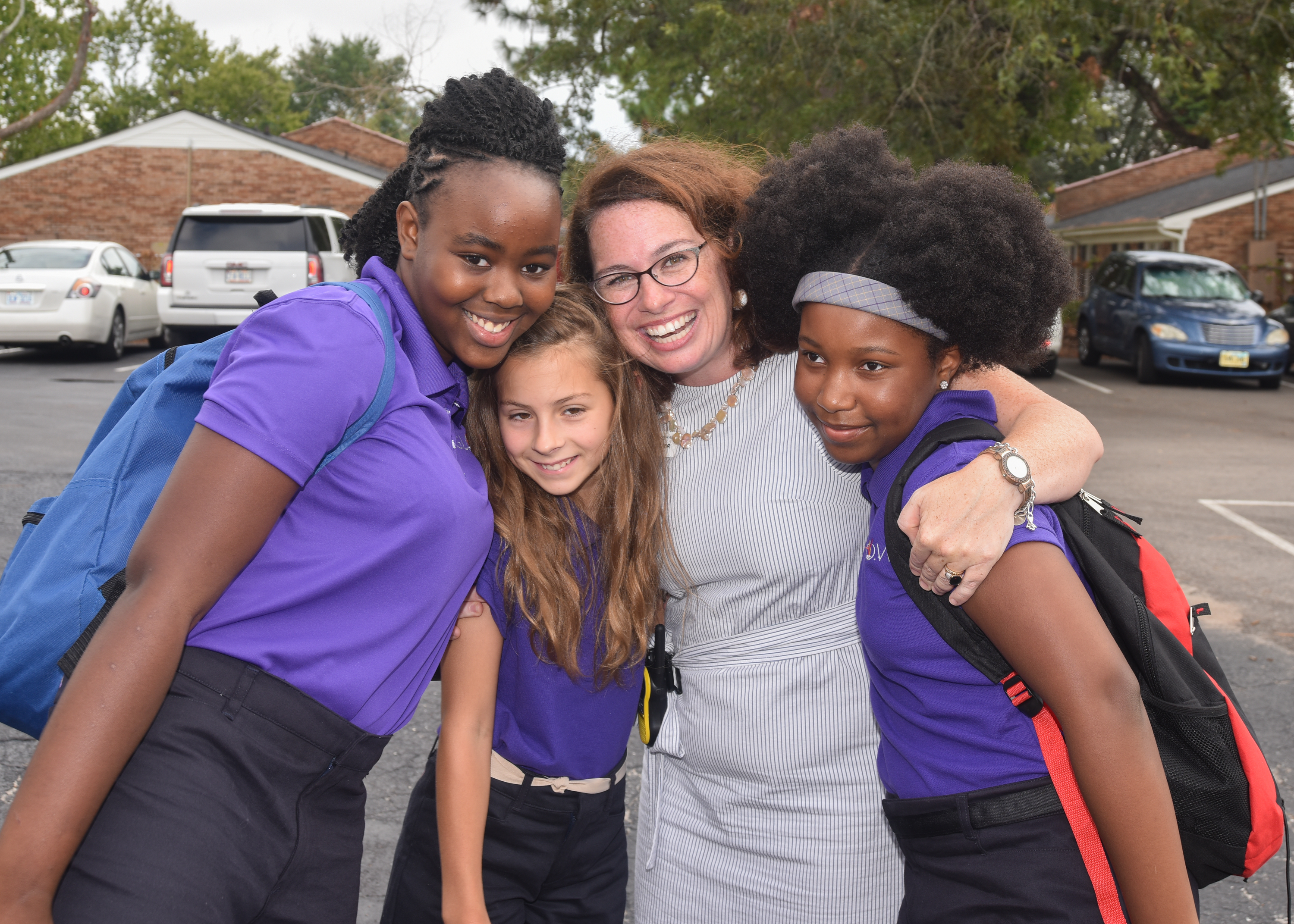 Three GLOW Academy students pose for a photo with Principal Laura Hunter, pictured middle right.