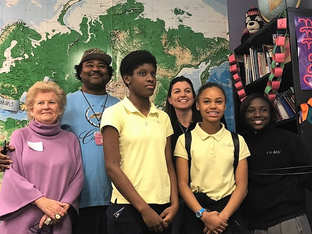 GLOW Academy students and staff pose for a photo with Judy Girard, pictured far left.