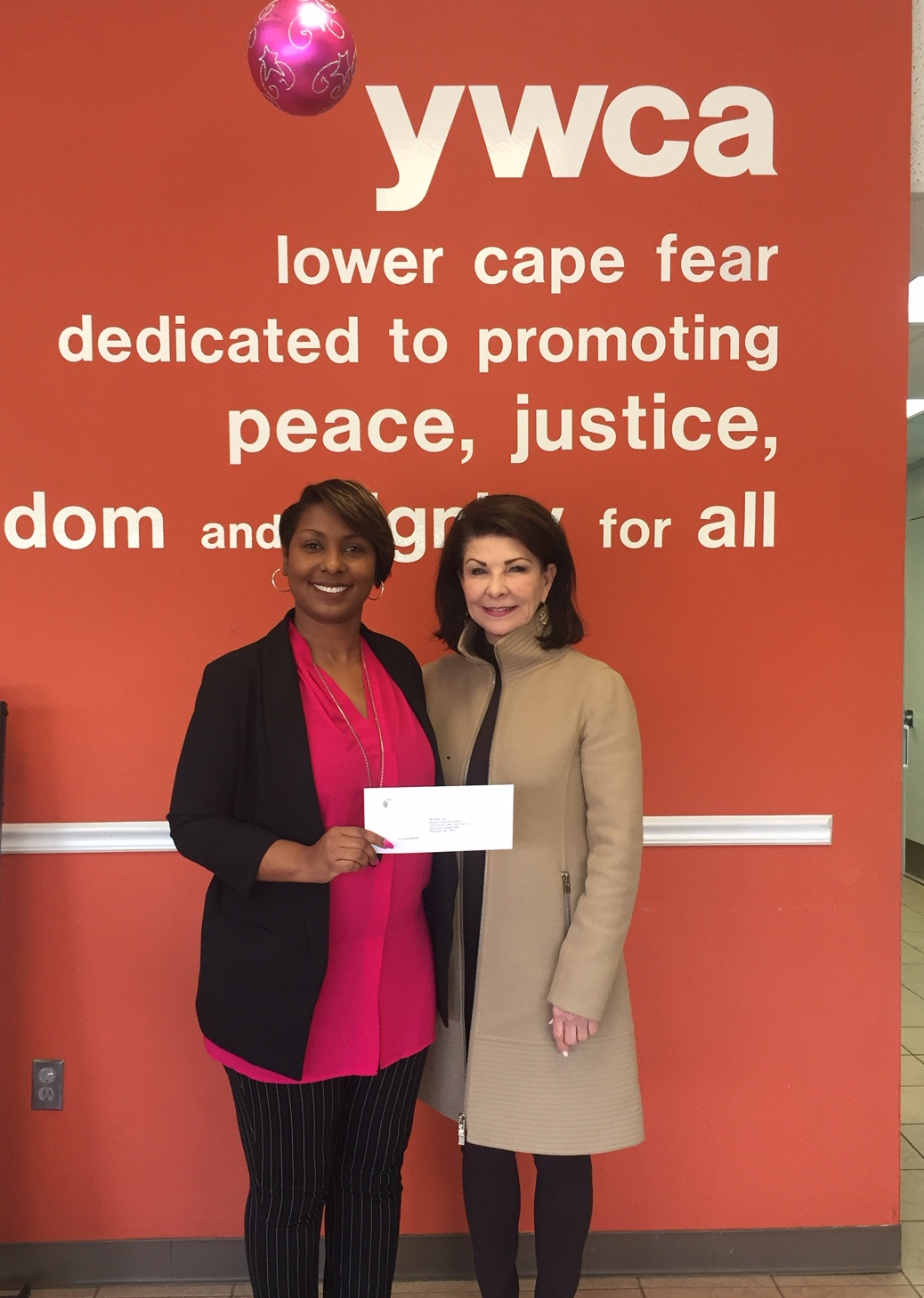 The Women's Fund was pleased to award a grant to the YWCA Lower Cape Fear, Wilmington for the New Choices Economic Empowerment program. Photographed here are (left) Charrise Hart, YWCA Lower Cape Fear CEO; and Anne Sorhagen, NCCF southeastern regional director.