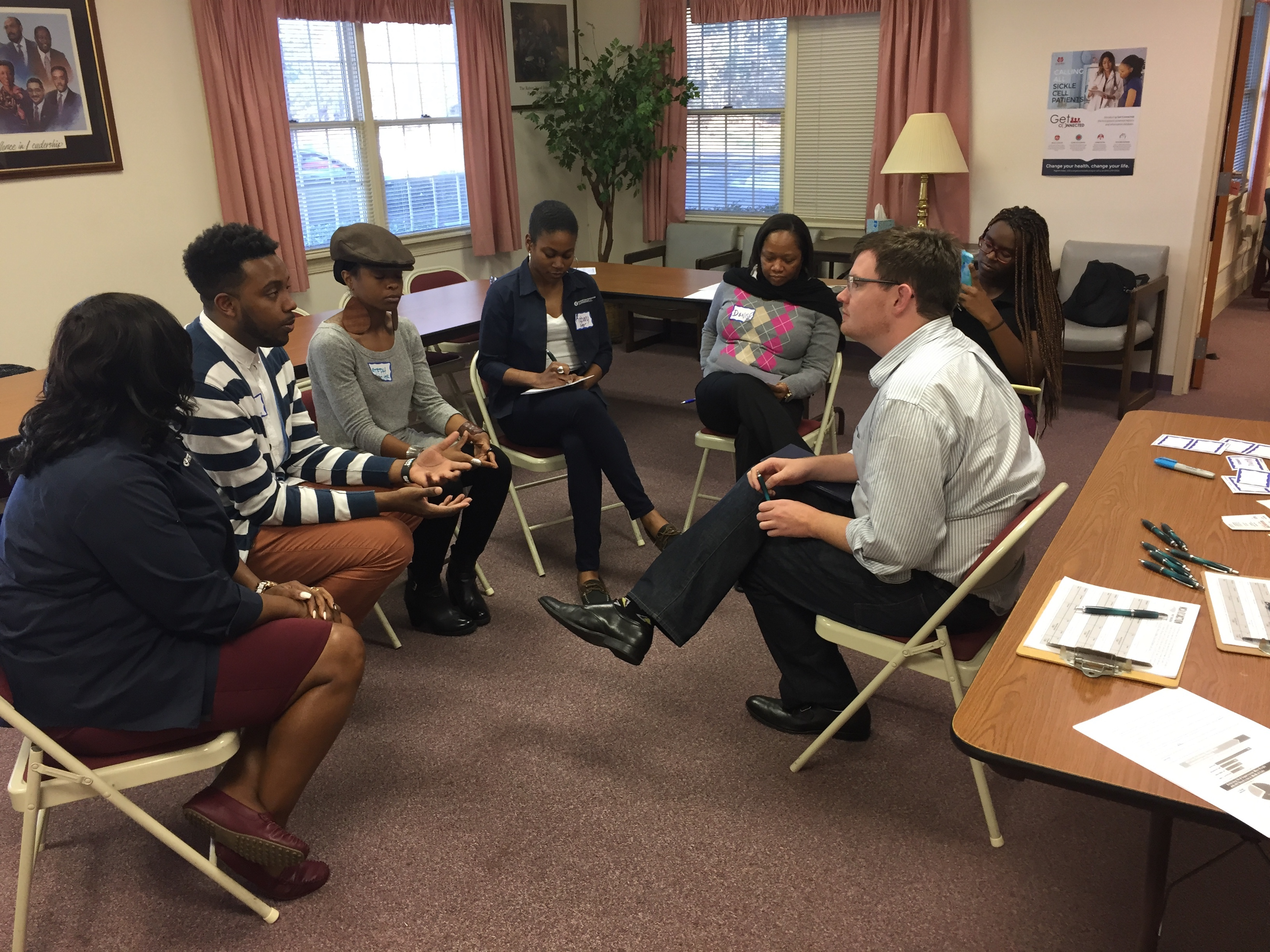 Pictured is Lee Storrow, executive director of the NC AIDS Action Network, meeting with community leaders and advocates. His organization created their first endowment with NCCF in 2019 and has already successfully grown the fund to support their work for years to come.
