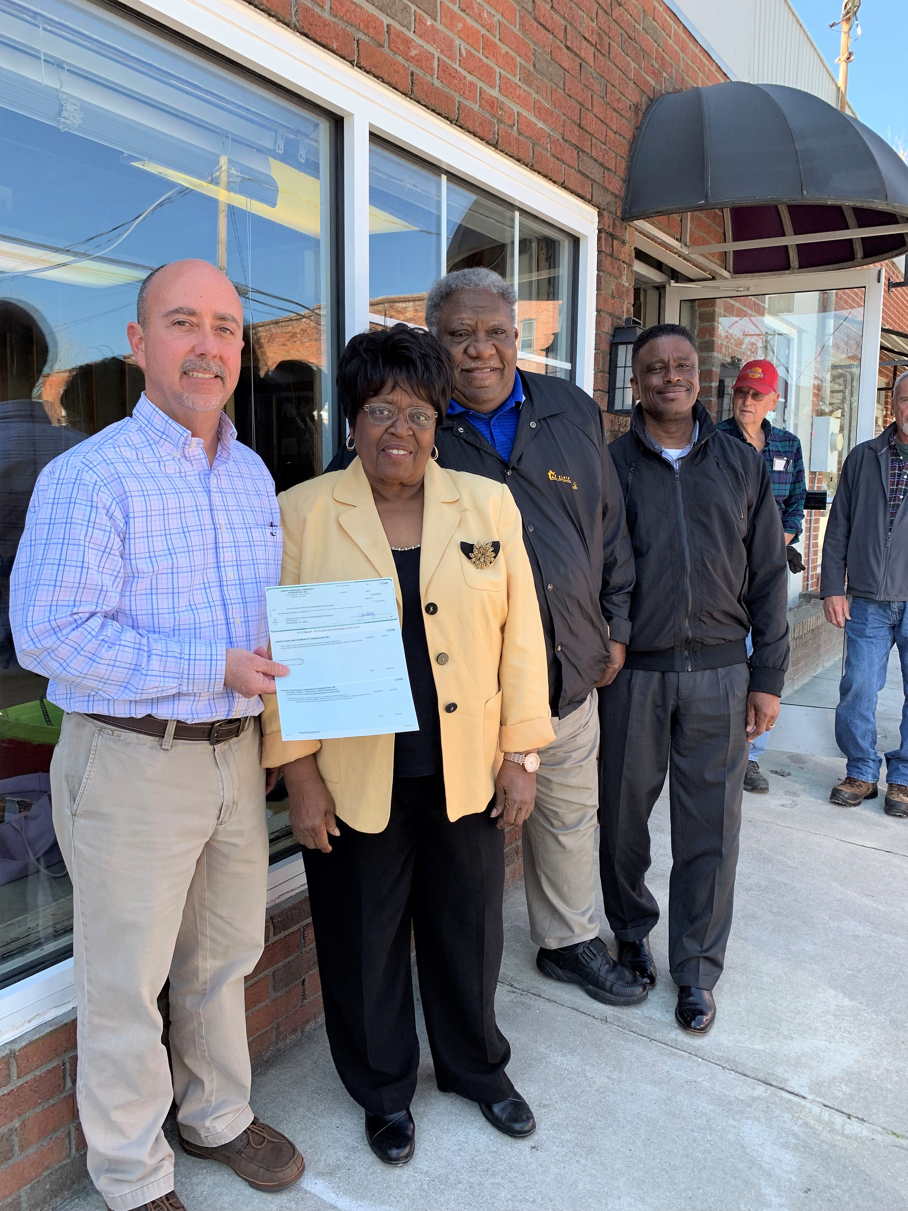 Pictured is the $10,000 grant being awarded to Jones County Community Development Corporation. Left to right are: Charley Jones, Joletha White, Johnny White and Solomon Jones.