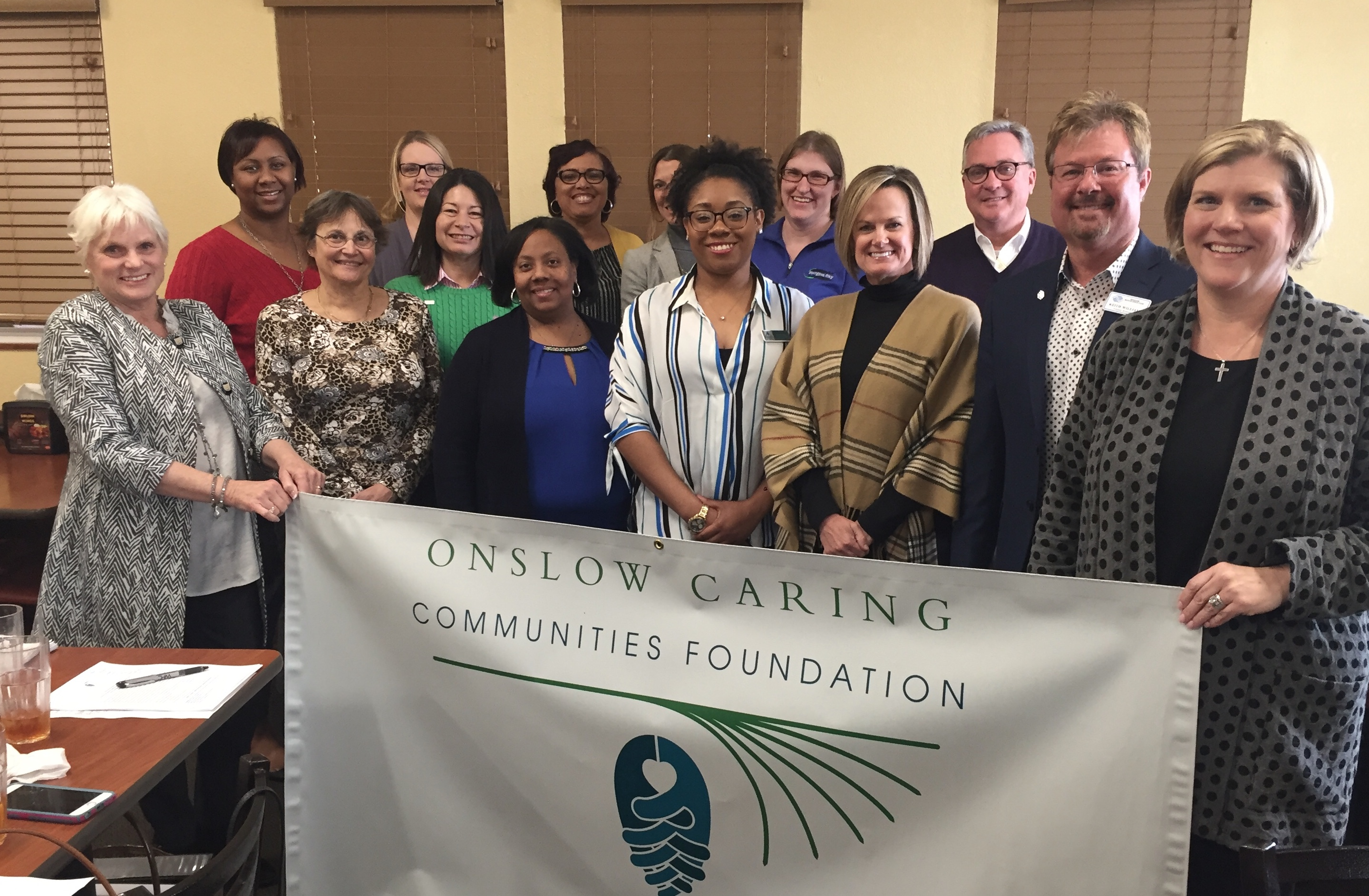 Onslow Caring Communities Foundation board members and grantee representatives gather for a photo at this year's grant awards ceremony where $34,880 in local grants were awarded.