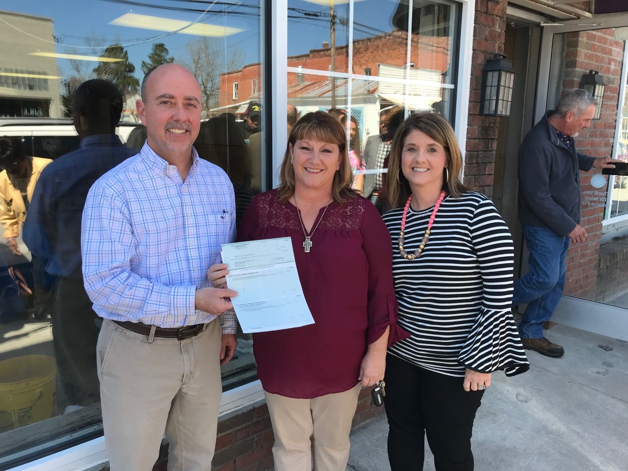Pictured is the $10,000 grant being awarded to Jones County RISE. Left to right are: Charley Jones, Joy Wynne and Taffy Jones.