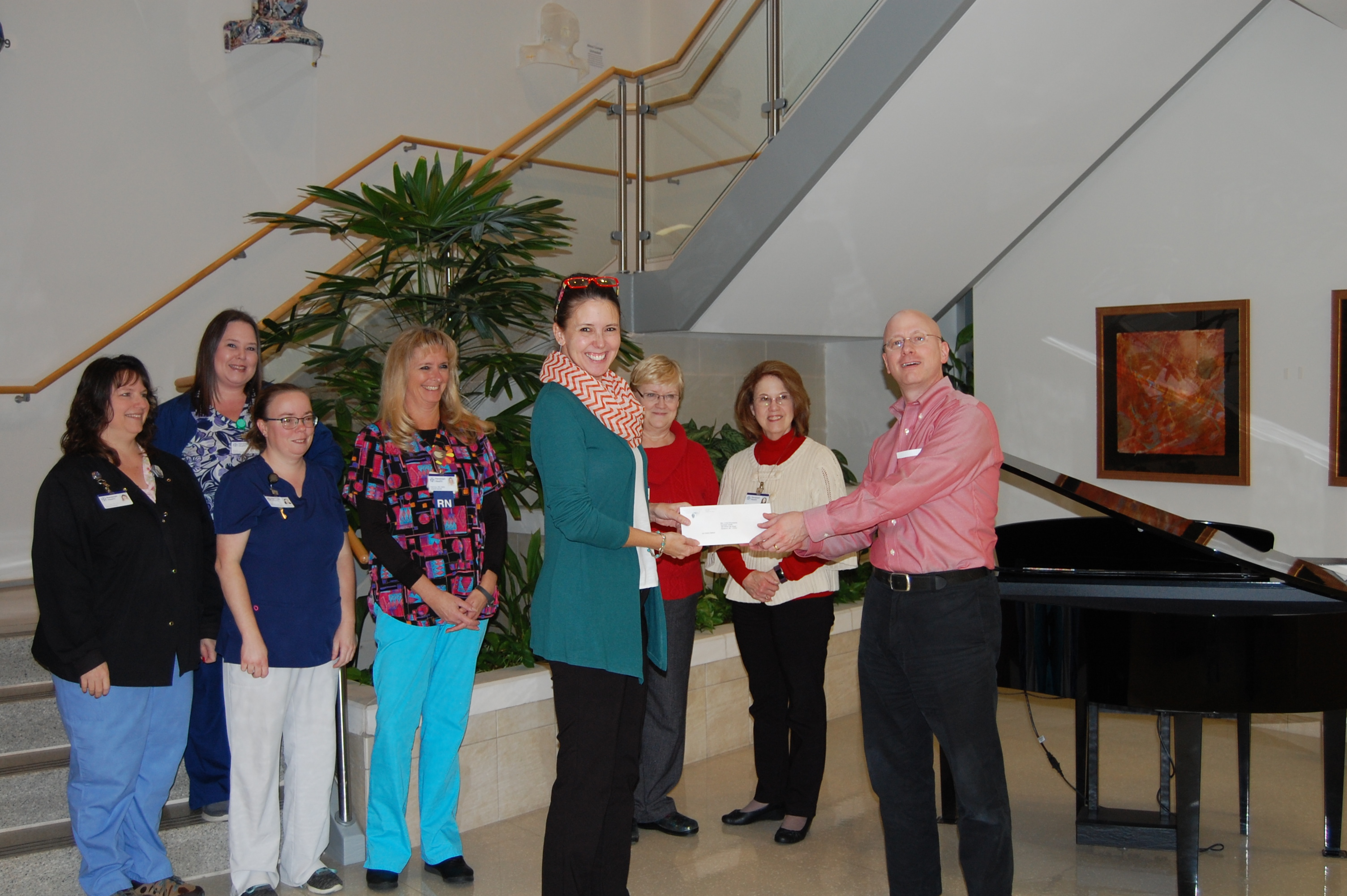 Staff members from Randolph Health are pictured accepting the grant award from NCCF Regional Director Dawn Neighbors.