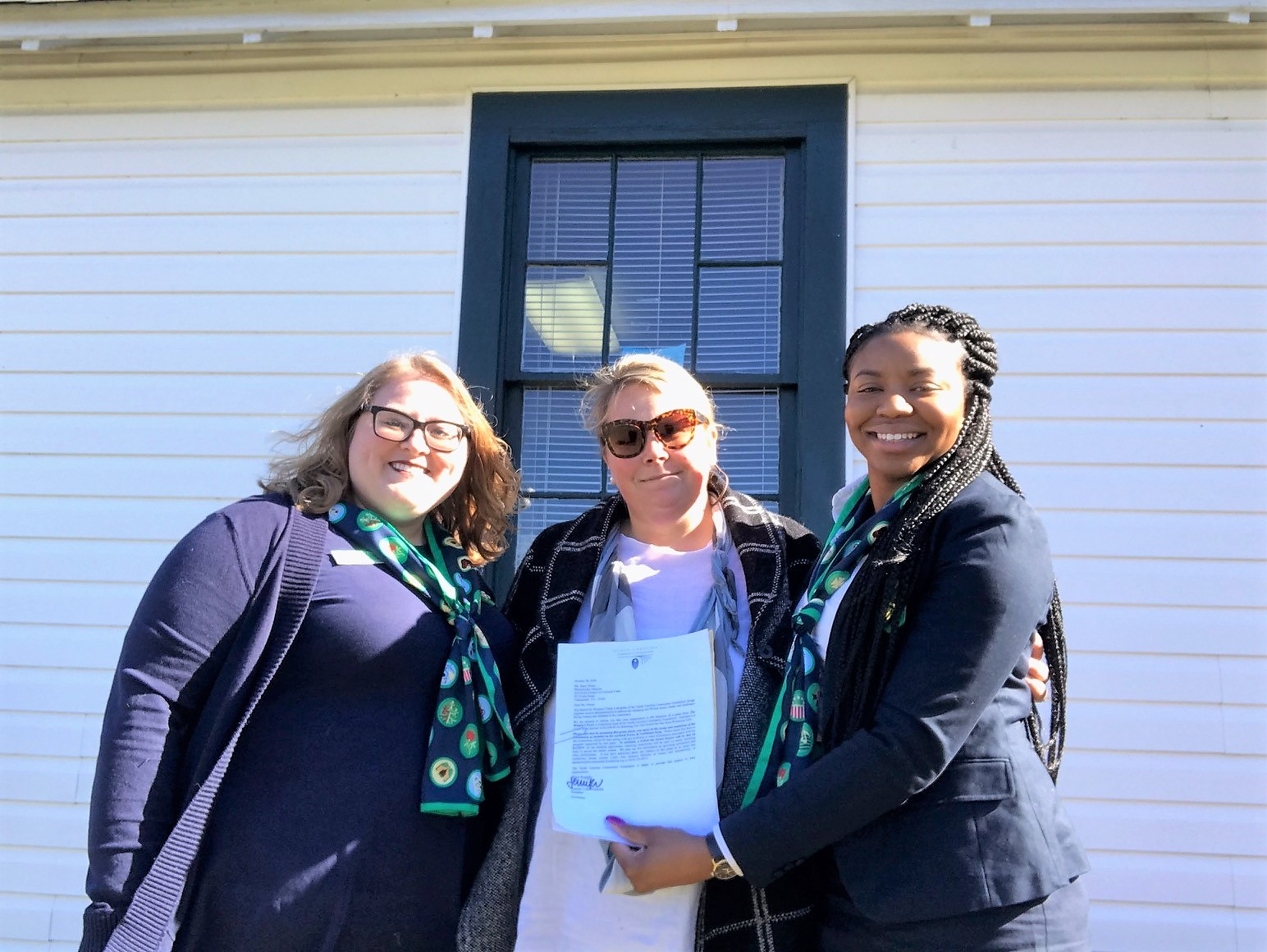 The Women's Fund of North Carolina awarded a grant to the Girl Scouts Council of Colonial Coast this year. Pictured accepting the grant are Jessica Woodyard (left) and Tameika Hopkins with NCCF Regional Director Natalie Peel.