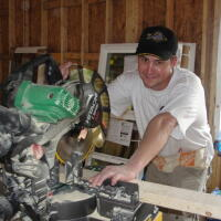 Volunteer with saw
