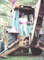 Bishop on a tractor