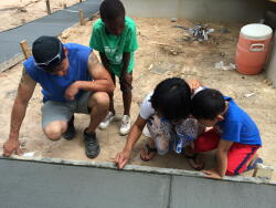 Habitat homebuyers Jaw and his wife, Maw, came to the site each day to watch the builders' progress. The family all carved their initials into the wet driveway cement.
