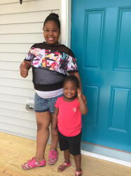 The Parrish girls are excited about their new home, and they love the bright blue door.