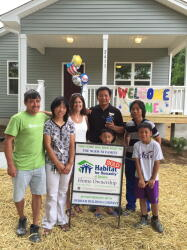 Dedication days are always special! The Ni/Ngeh and Parrish families pictures with their builder partners, Durham Building Company and Garman Homes.