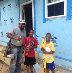 The next generation of Habitat youth, Jayden and Tyshawn, moved into their Habitat home in NECD last summer.