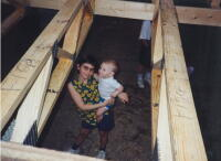 Heather and her youngest brother, Mason, on the Habitat construction site during the framing of their home.