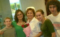 Marilyn and her kids at her pinning ceremony. Marilyn went back to school and is now a registered nurse.